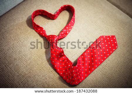 Red necktie shape of heart - stock photo