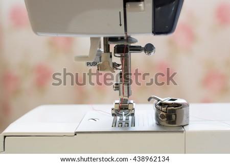 white sewing machine needles