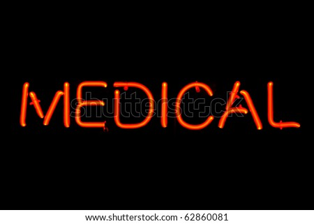 Red neon sign of the word 'Medical' on a black background.