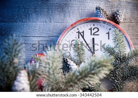 Red New Year clock on the wall - stock photo