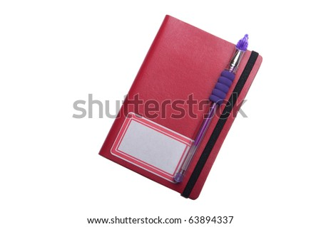 red notebook diary or agenda and purple pen lying on the top (isolated on white background)