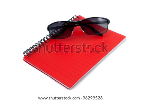 Red notebook isolate on white with sunglass - stock photo
