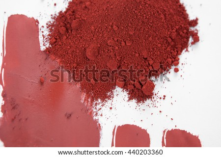Red ochre, also spelled ocher, a natural earth pigment based on hydrated iron oxide.