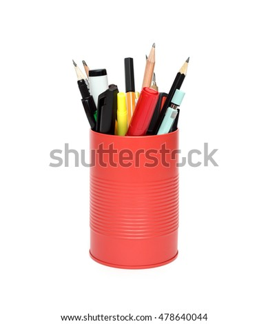 Red office pot with pencils and pens on a white background