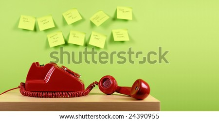 Red office telephone. Busy office concept.