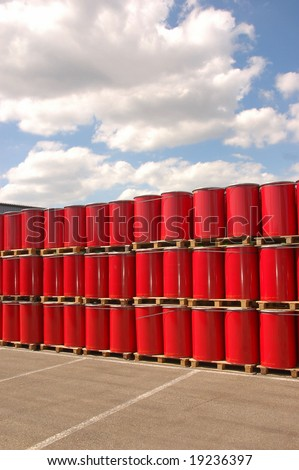 Red oil drums on a storage site - stock photo