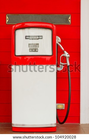 red oil station on red wall - stock photo