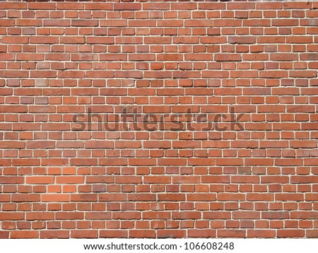 Red old and new bricks wall - stock photo