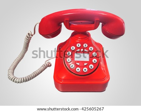 Red old-fashioned phone on isolated white background