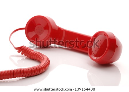 Red old fashioned telephone handset isolated on a white concept for urgent or important customer support call - stock photo