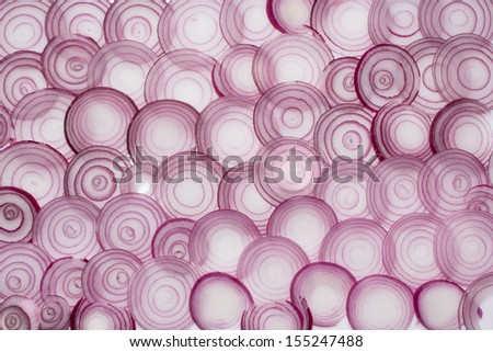 Red onion rings, on white background. - stock photo