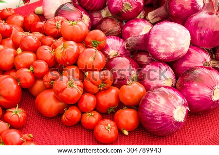 Red onions and red ripe tomatoes at the farm market