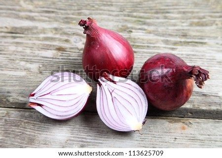 Red onions on a wooden table