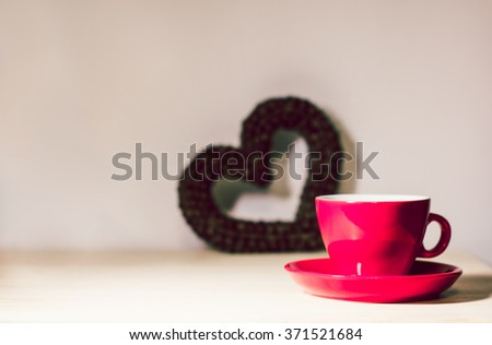 Red or pink cup and heart of the coffee beans. Valentine's Day. Be my Valentine. Theme of love, romance, coffee time, cafe. - stock photo