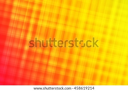 Red, orange, and yellow colors blend to create abstract background  - stock photo