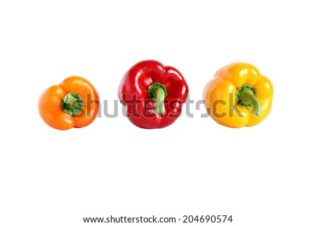 Red, orange, and yellow sweet paprika isolated on white