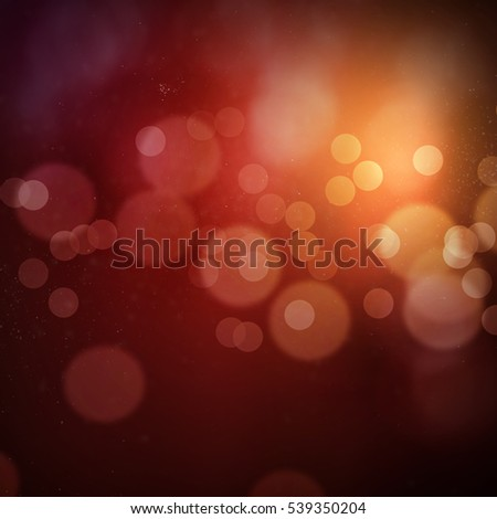 Red orange bokeh with dust, glitter, sparkles