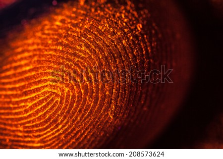 red-orange fingerprints on black, unfocused - stock photo