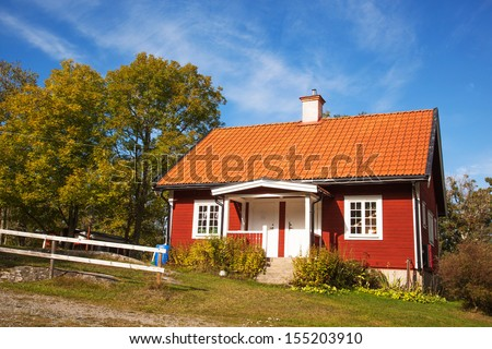 Red ordinary house in Sweden - stock photo