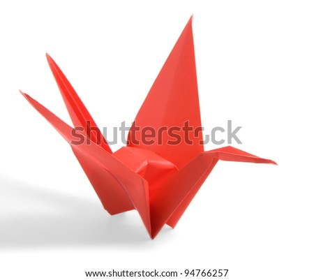 Red Origami Crane on a white background - stock photo