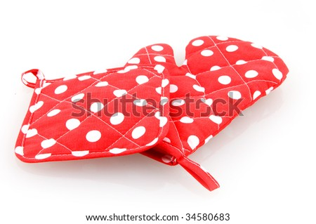 Red oven mitt and potholder isolated on white background - stock photo