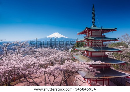 Red Pagoda with Mt Fuji on the background  - stock photo