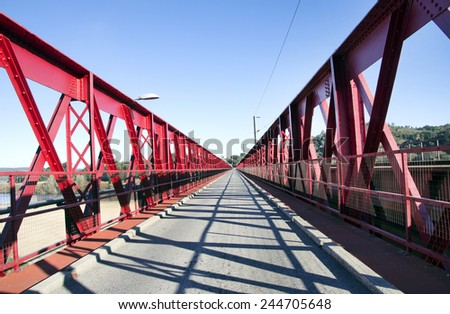 Red painted metal road bridge - stock photo
