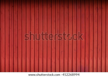 Red painted planks outside of a barn. Sweden - stock photo