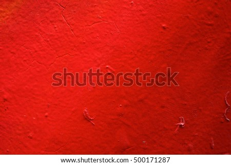 Red painted wall surface with texture