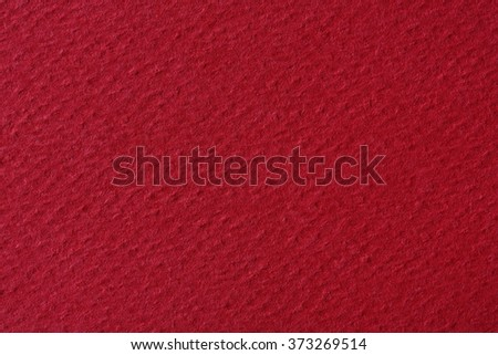 Red paper as a texture or background. - stock photo