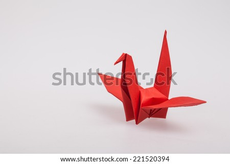 Red paper bird, origami. - stock photo