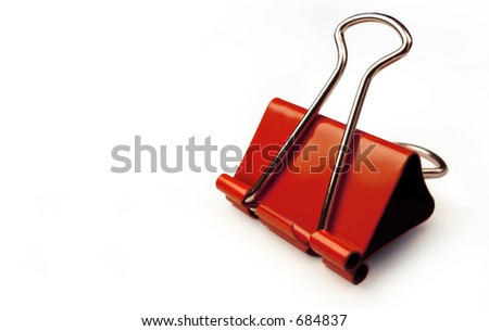 Red paper clip on a white background. - stock photo