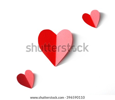 Red paper hearts isolated on white background, close up - stock photo