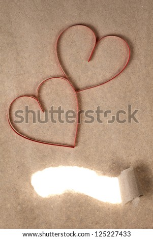red paper hearts on recycled paper, valentines background