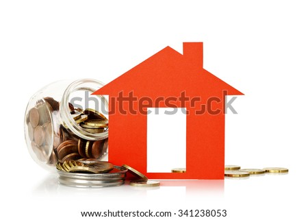 red paper house and jar with coins, house saving concept