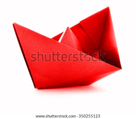 Red paper ship, origami sail boat, isolated on white background