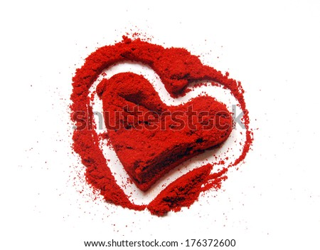 red paprika ground in heart shape - stock photo