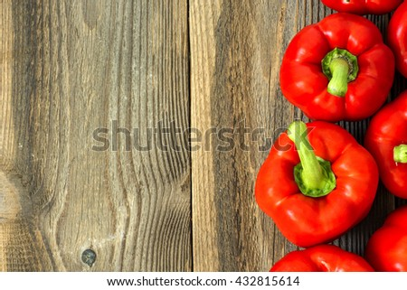 Red Paprika On The Wooden Table./Red Paprika On The Wooden Table - stock photo