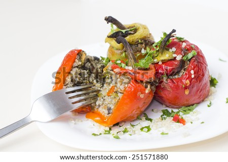 Red paprika stuffed with mushroom and rice filling - stock photo