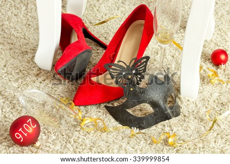 red party shoes with champagne glasses - stock photo