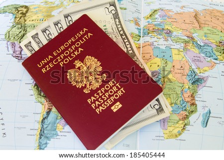 Red passports and money (polish zloty and dollars) over map background - stock photo