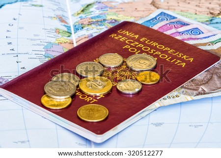 Red passports and money (polish zloty) over map background