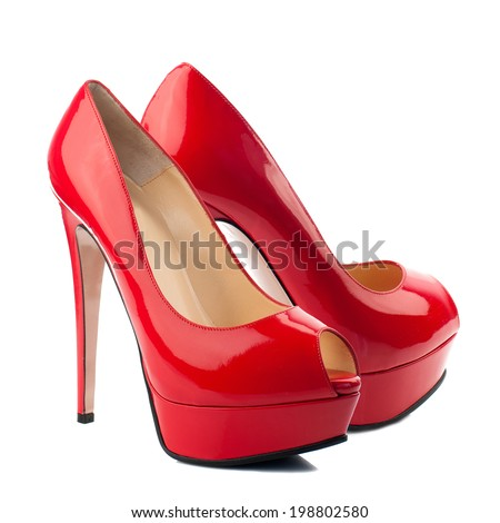 Red patent high heel women shoes isolated on white background. - stock photo