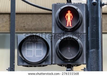 RED pedestrian traffic lights under sunlight - stock photo