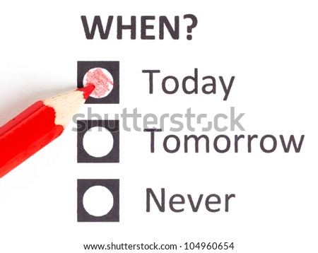 Red pencil choosing the right date (deadline) - stock photo