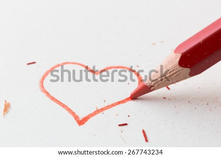 Red pencil drawing love heart - stock photo