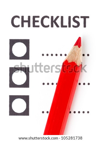 Red pencil on a checklist, isolated on white - stock photo