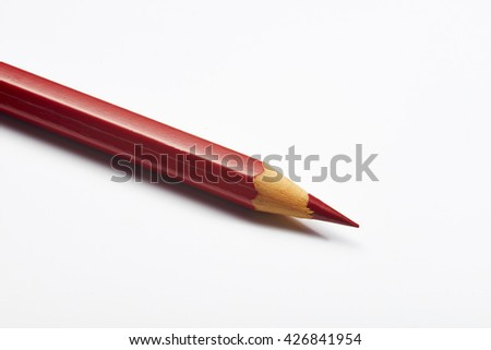 red pencil on white background
