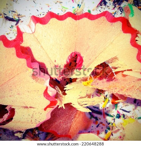 red pencil remnants after working with the penknife at school - stock photo