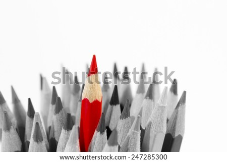 Red pencil standing out from others - stock photo